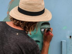 Aaron Glasson working on Mural at Perfume Point