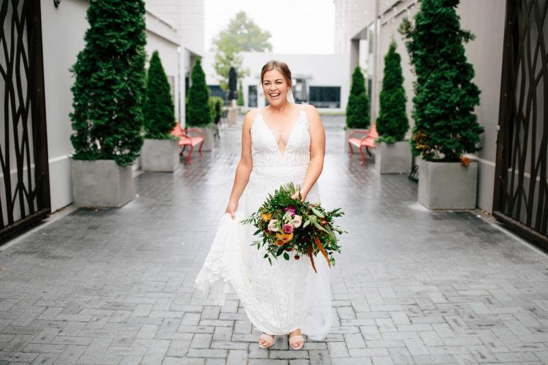 Bride in courtyard by Billie Brook